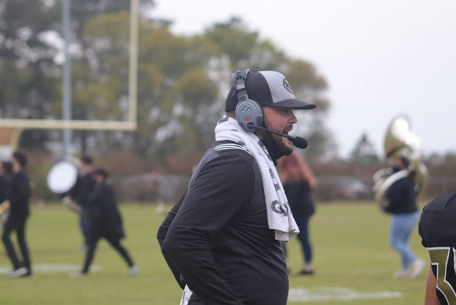 Croatan coach Andrew Gurley looks on during a game last season. The Cougars play host to East Duplin on Friday.