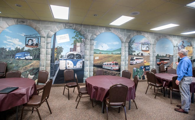 A mural in one section of the Peoria Charter Coach headquarters commemorates the founding of the company in 1941 by Walter Winkler, Bill Winkler's grandfather, and its development up to present day.