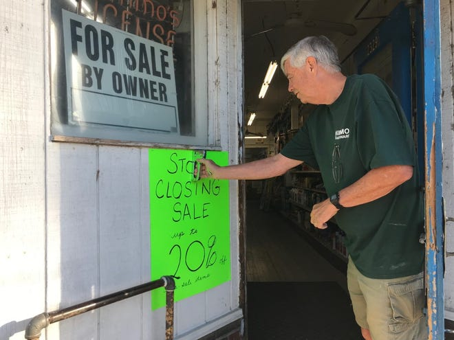 At Nimmo Hardware, owner Dave Campbell staples a sign to the entryway at 2329 W. Starr St. on Wednesday, Sept. 8, 2021, to announce the store's pending shutdown and an accompanying liquidation sale. With Campbell retiring, no buyer has come forward to buy the shop, the last hardware store in South Peoria.