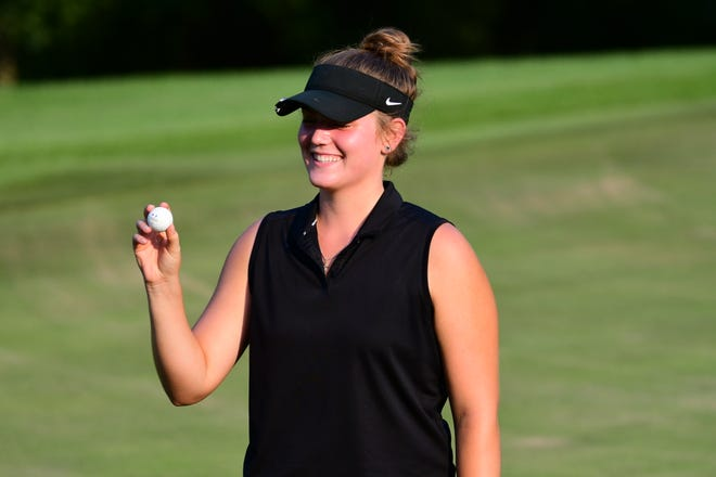 Kirksville's Addy Davis holds up her ball and poses after scoring an eagle on the eighth hole Tuesday at Kirksville Country Club.