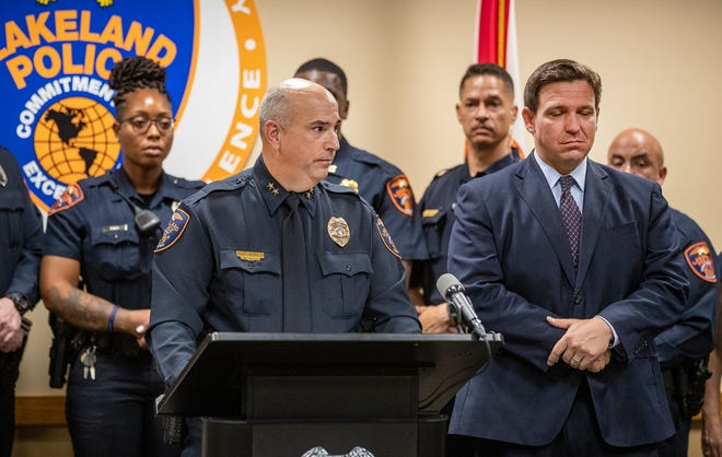 Lakeland Police Assistant Chief Hans Lehman and Florida Governor Ron DeSantis at the Lakeland Police Department to announce a hiring bonus for new Florida police officers at the Lakeland Police department in Lakeland  Fl. Tuesday Sept. 7 2021. Lakeland Police Chief Ruben Garcia did not attend as he was at home recovering from Covid -19 infection. ERNST PETERS/ THE LEDGER