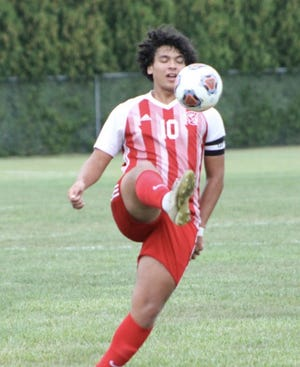 J'Von Miller boots the ball for Monroe during a 5-1 win over Bedford Tuesday.