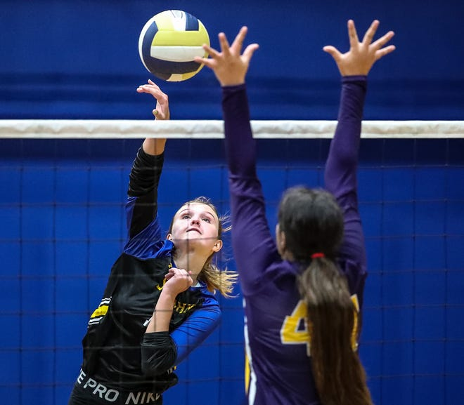 St John's Samantha Kreitstein hits a ball past a visiting Bell High School blocker, as the Saints win in four sets (23-25, 25-17, 25-20, 25-10) on Tuesday.