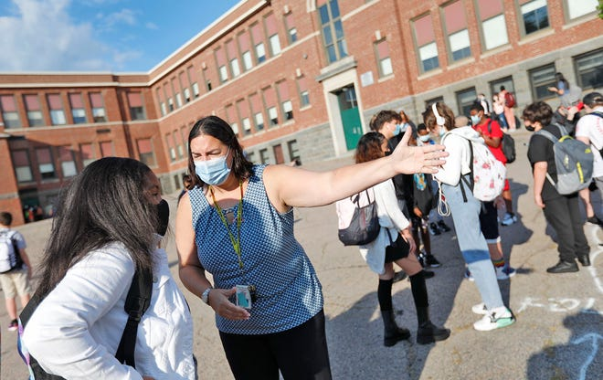 Point Webster Middle School Principal Christine Barrett directs a student to the correct entrance for her grade on the first day of school on Wednesday, Sept. 8, 2021.