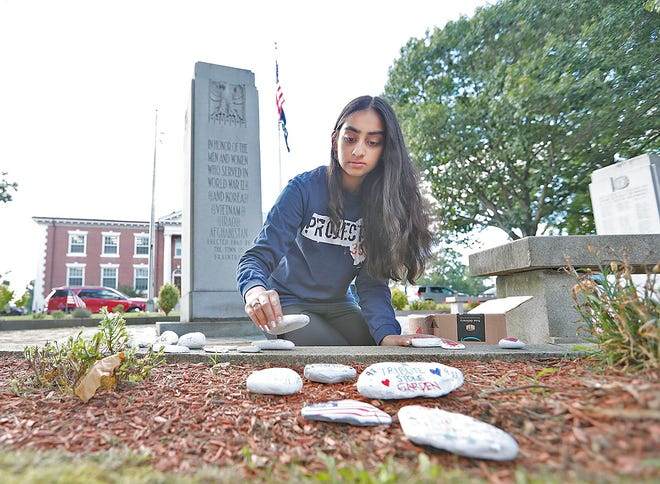 Anika Teckchandani, 15, a sophomore at Braintree High School, has created memorial stones for the garden in front of Braintree Town Hall as part of her community service project.