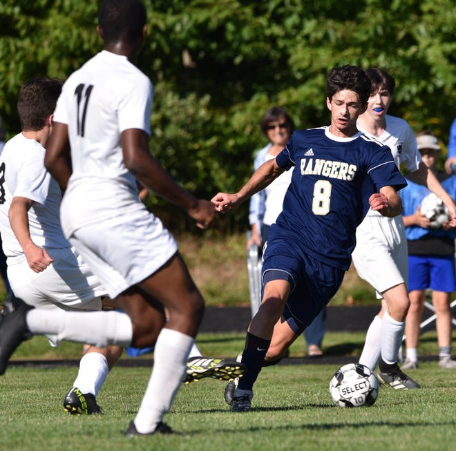 Traip Academy senior Owen Woollacott moves the ball up the field during Tuesday's boys soccer match against St. Dominic's.