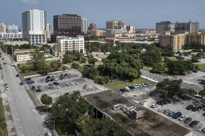 """This Aug. 24, 2021 photo shows Datura Street, left and Evernia Street, right, in West Palm Beach, Fla. In back-to-back, unanimous votes, commissioners in Palm Beach County and West Palm Beach approved preliminary plans to have the University of Florida open a campus near downtown, a move supporters described as """"historic"""" and """"transformative.""""  (Greg Lovett /The Palm Beach Post via AP)"""