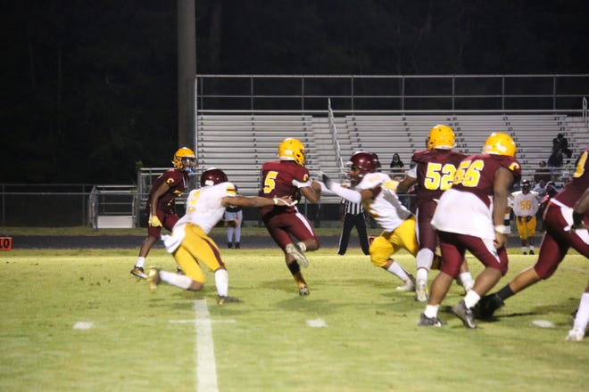 Sophomore quarterback Jahmad Lundy tries to create some momentum on offense in the fourth quarter.