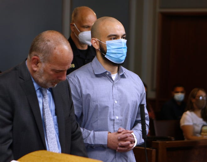 Elias Romero , with his lawyer William Dimitri. admits to killing his 3-month-old son in 2016. The Cranston father entered a plea in Superior Court Wednesday afternoon.