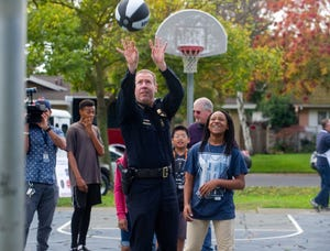 (2016/11/21) Stockton Police Chief Eric Jones shoots free throws with area children at the Stockton Police Department's community BBQ at Loch Lomond Park in north Stockton. CLIFFORD OTO/THE RECORD.
