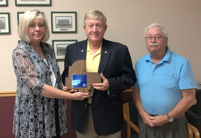 MRPC Executive Director Bonnie Prigge (left) presents Gasconade County Presiding Commissioner Larry Miskel with a plaque recognizing his service as board chair. Steve Vogt with city of Belle (right) took over chairman responsibilities at the June meeting.