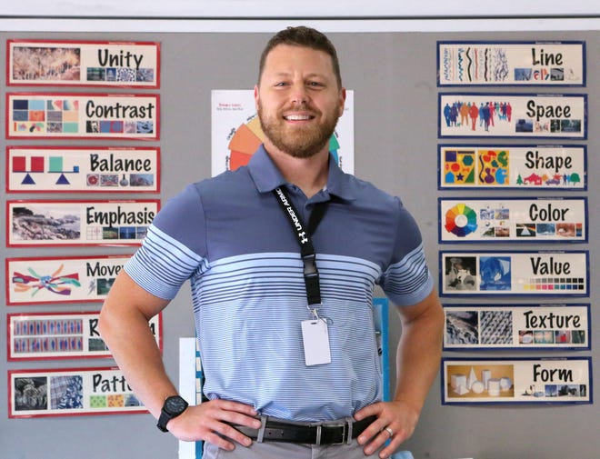 Cliff Seeman, a visual arts teacher at GlenOak High School, is a Walsh University Teacher of the Month. He is shown at the school Wednesday, Sept. 8, 2021.