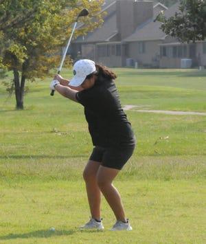 Salina South's Zoe Norton swings through a shot during Tuesday's Salina Central Invitational at Salina Municipal Golf Course.