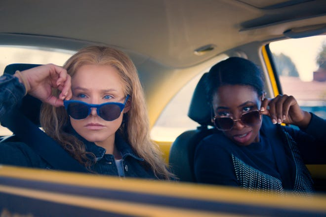 """Kristen Bell, left, plays Connie Kaminski and Kirby Howell-Baptiste plays JoJo Johnson in """"Queenpins,"""" a new movie written and directed by South Bend native Gita Pullapilly and her husband, Aron Gaudet."""