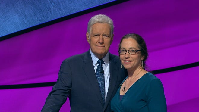 """Dowagiac resident Jennifer Quail poses with Alex Trebek. Quail was a contestant on the game show """"Jeopardy"""" in 2019, when Trebek, who died in November 2020, was the host. She won big then and was invited back for the just-aired """"Tournament of Champions"""" in spring 2021."""