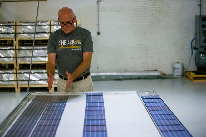 Patrick Regan talks about the process of making solar panels Wednesday at Crossroads Solar in South Bend. A former professor, Regan left the University of Notre Dame to create good-paying jobs for former felons producing solar panels.