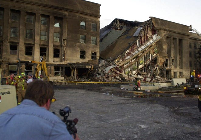 Damage to the Pentagon is shown Tuesday, Sept. 11, 2001, after a hijacked airliner crashed into the building. (AP Photo/Steve Helber)