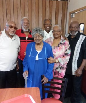 From left: Ray Williamson, James Williamson, Esther Williamson, Harold Williamson, Patricia Flack and Gene Williamson pose for a family photograph.