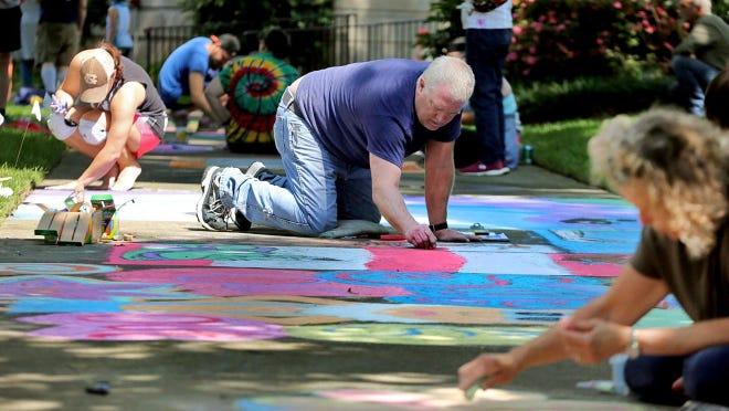 Artists bring their creation to life during at a previous Chalk Fest event.