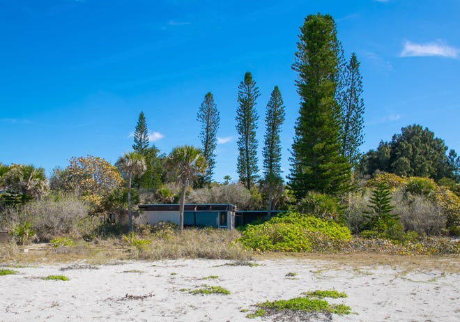 A view from the Gulf of Mexico of the Sarasota School of Architecture Home now owned by Craig and Julie Hoensheid. The existing structure, which was built in 1954, would still be the westernmost portion of the home, though the couple plan an addition that would wrap around to the north and the east.