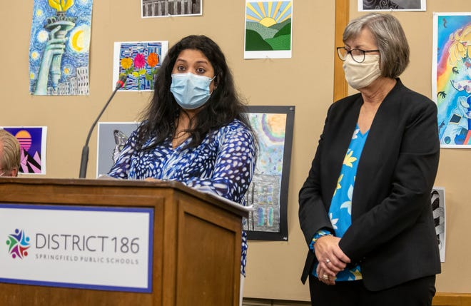 Dr. Vidya Sundareshan, left, co-chief of the infectious diseases division of SIU Medicine and a medical adviser to the Sangamon County Department of Public Health, and Gail O'Neill, director of the Sangamon County Department of Public Health, answer questions relating to the COVID-19 pandemic during a Springfield District 186 board of education meeting at the District 186 headquarters in Springfield on Tuesday.