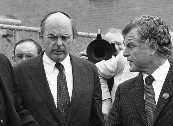 In this Oct. 14, 1982, photo, Illinois Democratic gubernatorial candidate Adlai Stevenson III, left, talks with Sen. Edward Kennedy as they finish a series of appearances in Chicago. Stevenson III, of Illinois, has died at his home on Chicago's North Side. He was 90. On Tuesday his son, Adlai Stevenson IV, confirmed the Democrat's death and said his father had dementia.