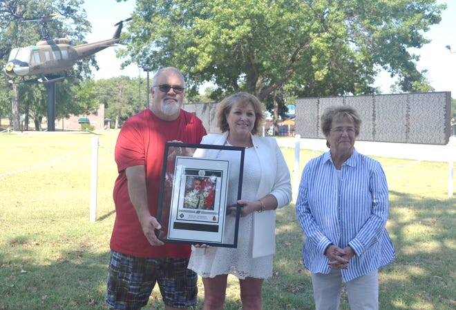 Gold Star family members Marvin and Donna Warren, left, and Nancy Ford, right, gather at Woodland Veterans Park to support fundraising for a Gold Star Family Memorial Monument.
