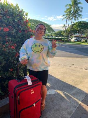 Sixth grade science teacher Alisia Cabral from Alma del Mar arriving to Big Island at Kona Airport.