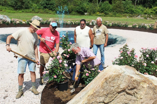 """David Nardozzi of Allegheny County, J.T. Kline of Berlin, Joe Costa and Bill Cenk of Allegheny County, and Clay Mankamyer (kneeling) of Friedens, chairman of the Remember Me Rose Garden, planting hybrid tea roses at the """"living tribute"""" garden on Tuesday in preparation for the 20th anniversary of Sept. 11 on Saturday."""
