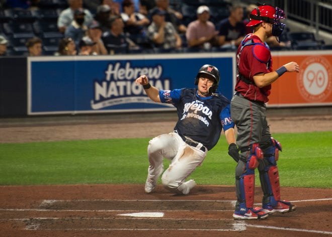 Tate Matheny, shown scoring during Tuesday's game, homered to help WooSox to a win on Sunday.
