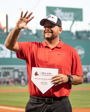 Andy Sharry of Paxton is recognized during a Little League Volunteer Coach of the Year ceremony before a game between the Boston Red Sox and the Tampa Bay Rays at Fenway Park on Tuesday.