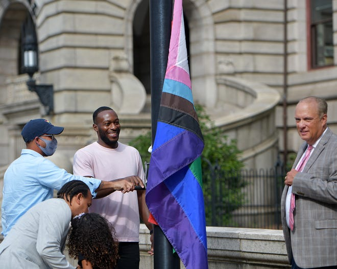 Al Green, ministry director LGBT Asylum Task Force, was all smiles as he raised the Pride flag with City Councilors Sean Rose and Khrystian King beside him Wednesday with Mayor Joe Petty at right.