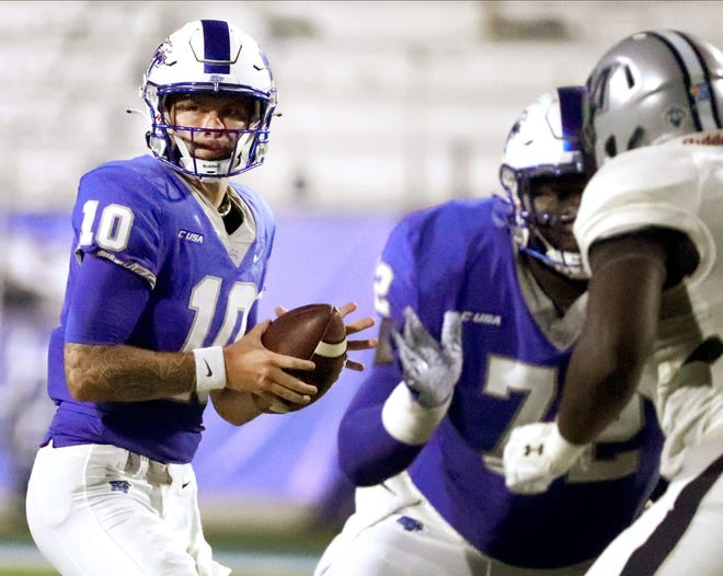 MTSU quarterback Bailey Hockman (10) looks for a player to pass to as MTSU offensive lineman Netori Johnson (72) blocks for him during the game against Monmouth Hawks on Saturday, Sept. 4, 2021, at MTSU.  14 Mtsu Vs Monmouth