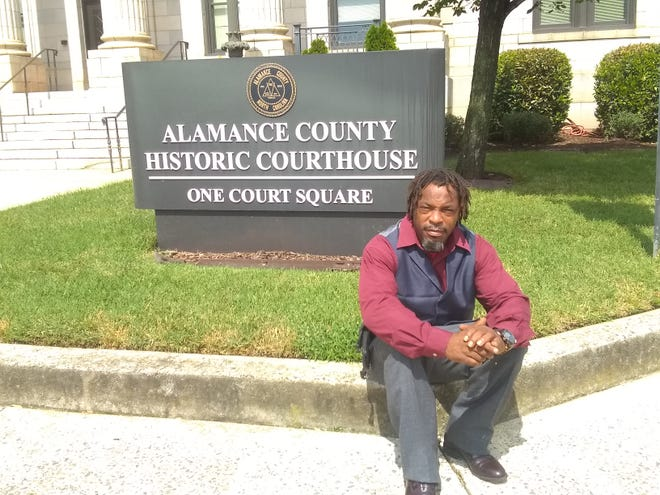Keith Sellars sits outside Alamance County's Historic Courthouse on Sept. 8. Sellars was one of the most prominent of the 12 individuals who were arrested for casting ballots in the 2016 election.