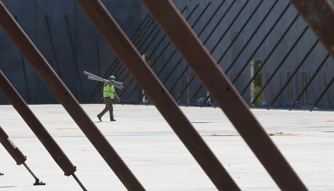 Crews work on a spec building to attract new business at Venture Crossings in Bay County in 2019. A new manufacturer is eyeing the industrial park to build a facility and bring 200 jobs to the county.