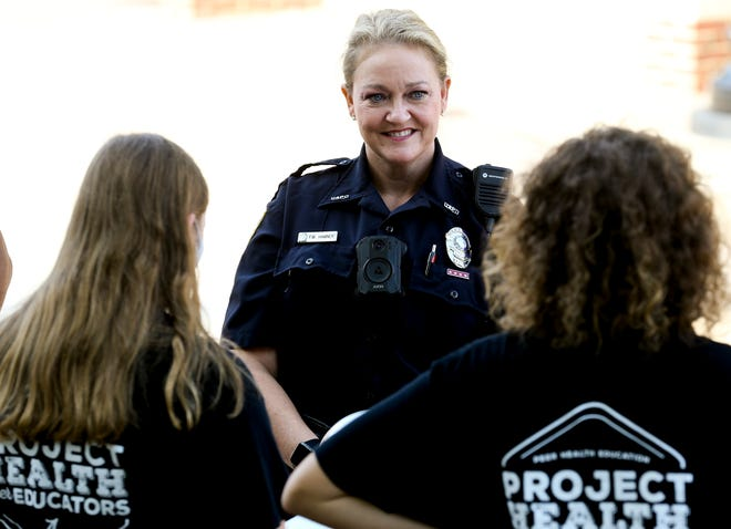 University of Alabama police officers focus on community policing efforts. Officer Margaret Hamner stops to speak to students involved in health education outside the Ferguson Center Wednesday, Sept. 8, 2021. [Staff Photo/Gary Cosby Jr.]