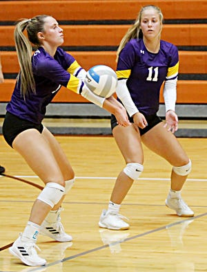 Watertown's Kendall Paulson receives a serve as teammate Jaclyn Llloyd (11) looks on during a high school volleyball match Tuesday night in Huron. The host Tigers won 3-1.