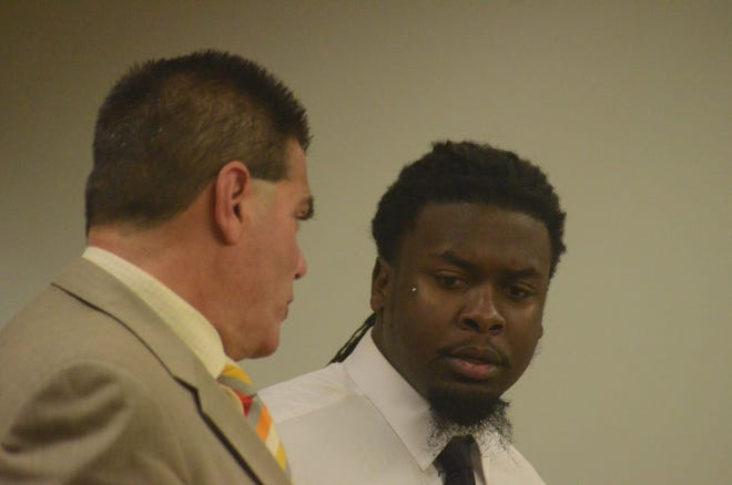 Khanas Ware, right, talks with is attorney, Michael Maddaloni in court Wednesday.