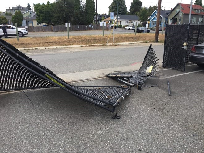 A man is accused of driving through the fence at Bremerton Police headquarters on Saturday.
