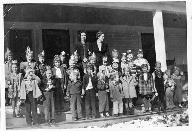Teachers of the Black Mountain Kindergarten pose with their students in 1951.