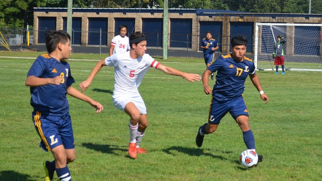 Javi Llanes of Lindenwold (17) angles toward the sideline as Haddon Township's Dermot Sheehan gives chase during Tuesday's Colonial Conference game.