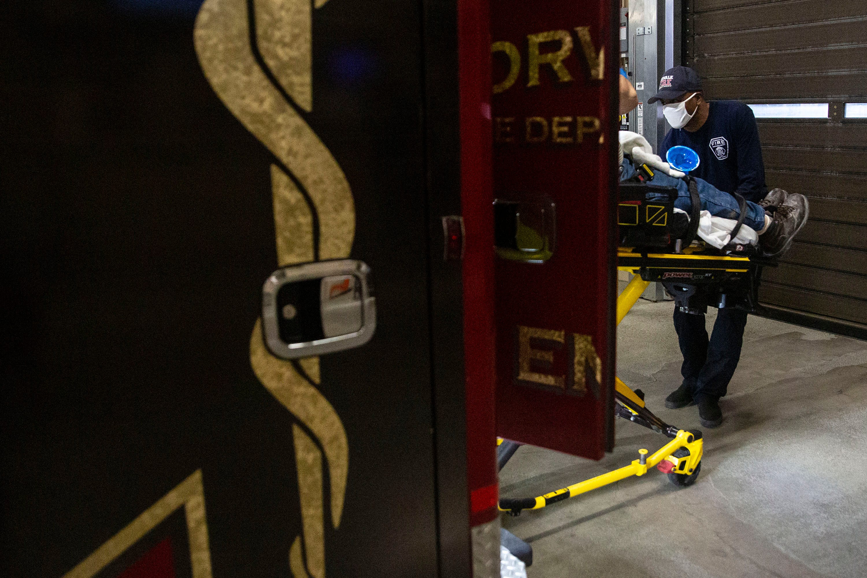 Jeff Price, a Norwalk EMT, brings a patient to the emergency department at Iowa Methodist Medical Center early Friday morning, Sept. 3, 2021, in Des Moines.