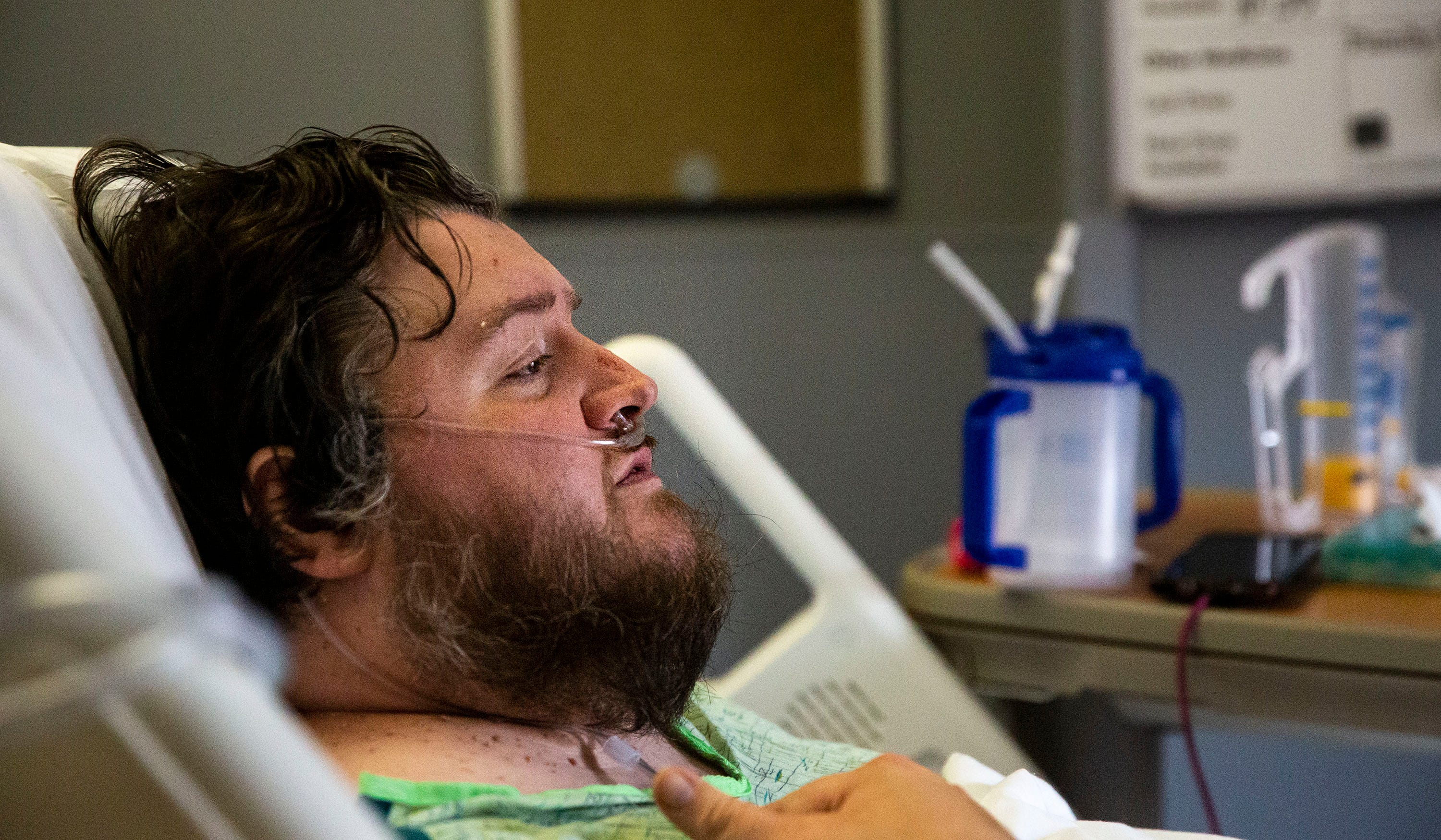 Mark Galvan, 40, of Scranton, recovers from COVID-19 in his hospital bed at Iowa Methodist Medical Center on Friday morning, Sept. 3, 2021, in Des Moines.