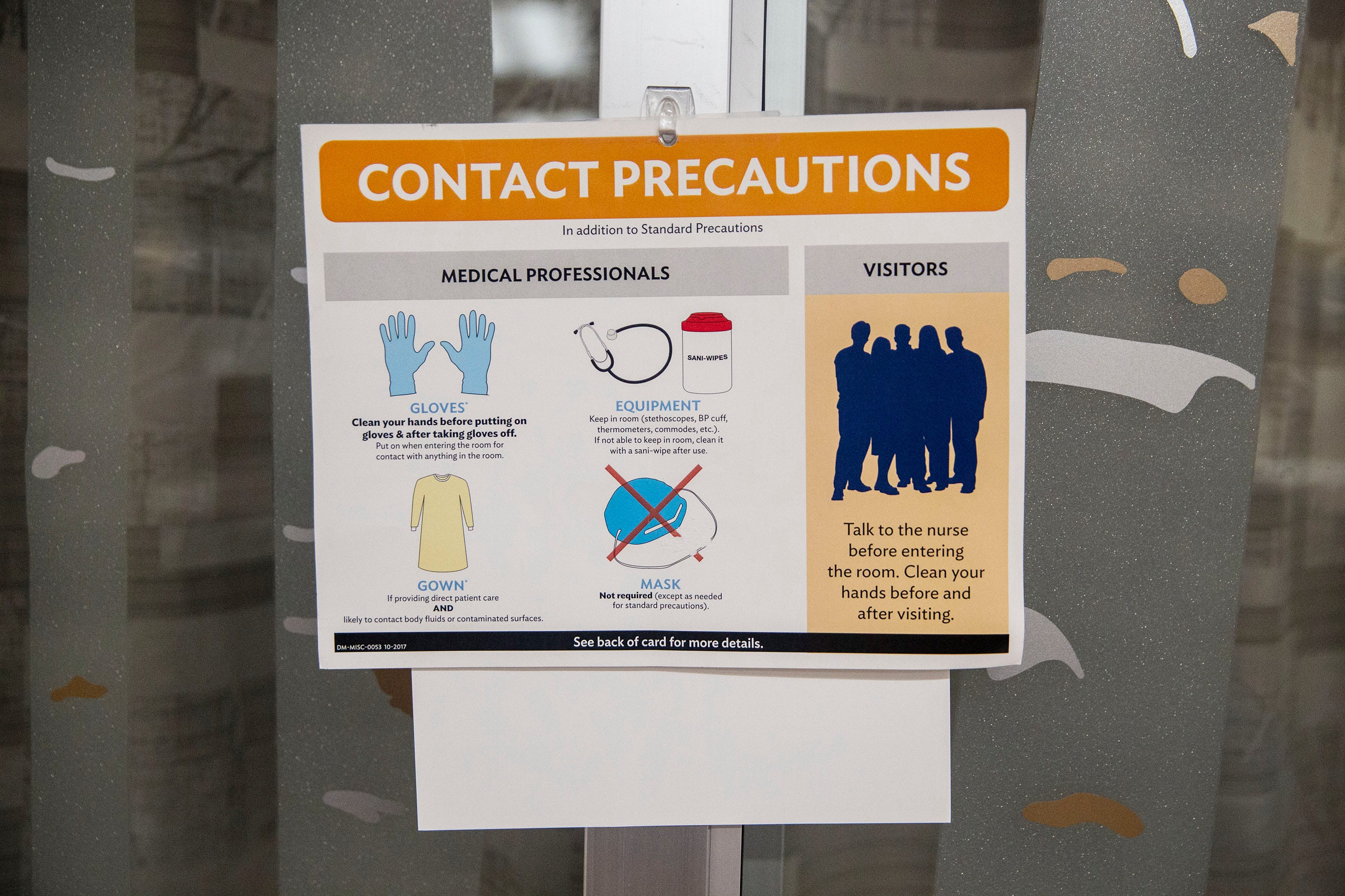 A sign about COVID-19 protocol and precautions hangs outside of a patient room in the emergency department at Iowa Methodist Medical Center early Friday morning, Sep. 3, 2021, in Des Moines.