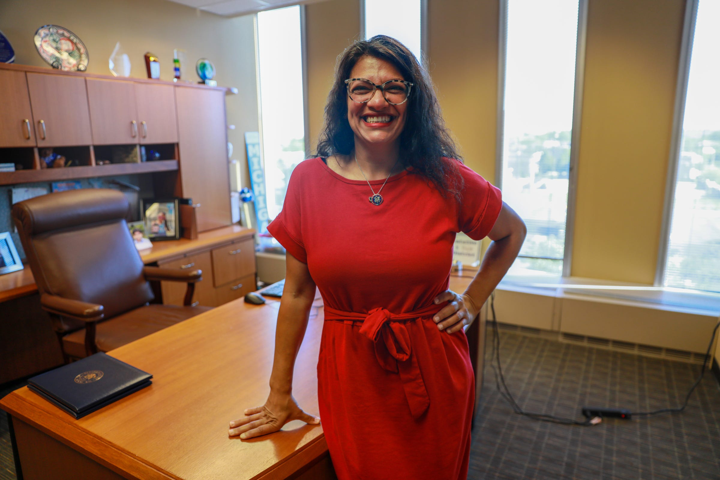 """Twenty years ago, U.S. Rep. Rashida Tlaib was 25, the American-born daughter of Palestinian immigrants, working her way through law school and working at Dearborn-based social service agency ACCESS. """"Working at the largest Arab American human services agency in the country, all of a sudden we became a target. We had to stop mourning at that moment, and start reacting to what would come next,"""" Tlaib said. In the two decades since, she has become Michigan's first Muslim female lawmaker, one of the first two Muslim women to serve in the U.S. Congress, a proud mother of two sons and a recipient of an unending stream of vile hate mail and dangerous threats that Tlaib says existed before 9/11. 9/11 was just the vehicle."""