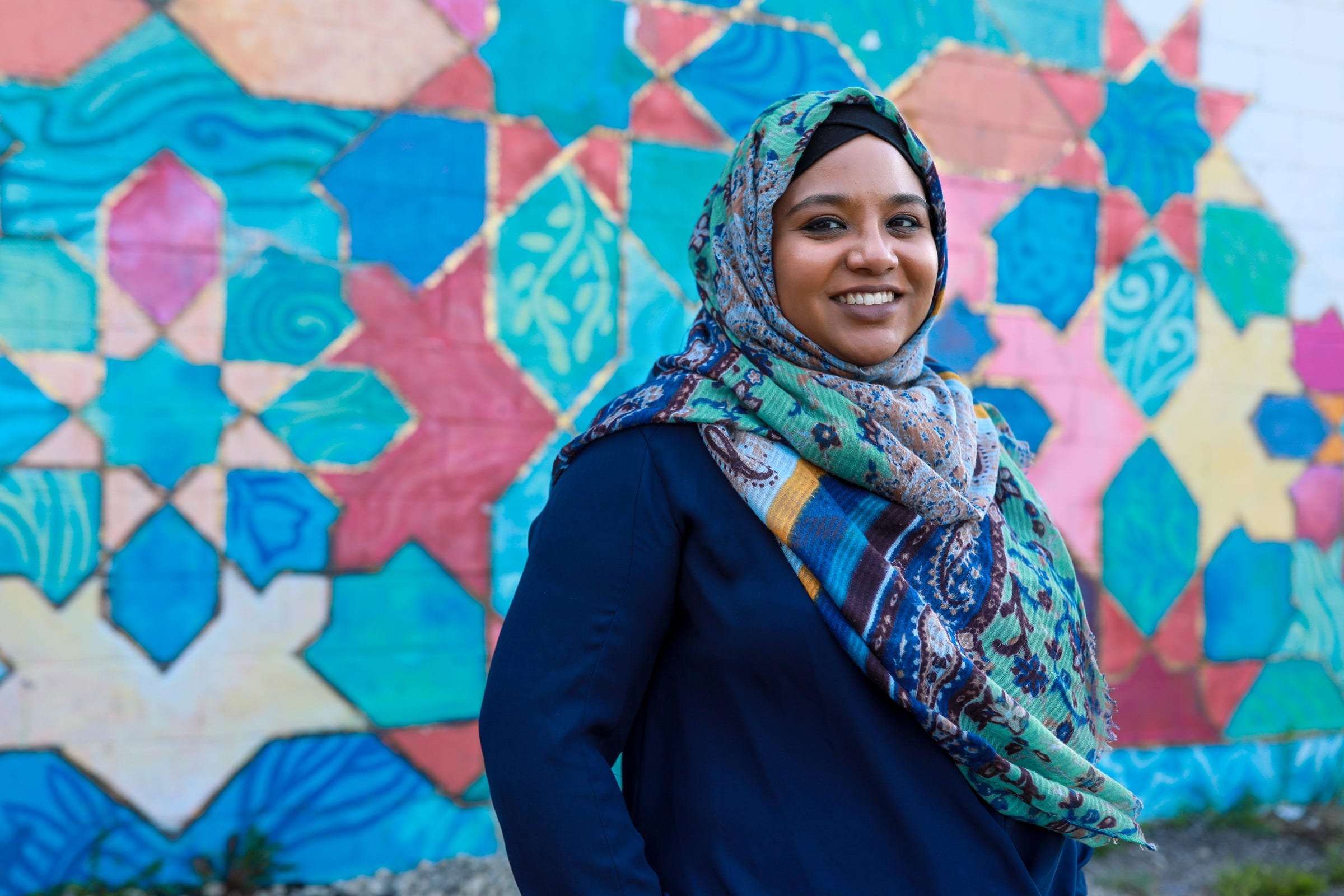 """Namira Islam Anani, 33, of Detroit, is a graphic designer and a lawyer who works as the associate director of ProInspire, an organization that activates leaders at all levels to insure equity for the individual, the organization and systemically. Anani's parents are from Bangladesh, and she grew up in Novi. On 9/11, Anani says she remembers the television being on in her 10th-grade class and it being real quiet, """"the internal reflection was a lot louder than what was happening around me,"""" said Anani. Anani didn't start wearing a hijab until she was 19 and in college, which she says gave her freedom and at the same time a sense of defiance. """"There is a deep discipline and spirituality to being Muslim and we are the most racially and ethnically diverse religious group in United States."""" Anani believes one Muslim can't represent the entire community."""