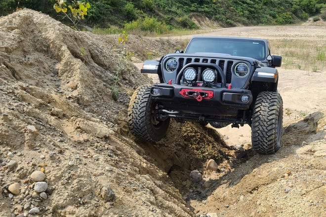 A Jeep Gladiator Rubicon navigates a gulch in Holly Oaks ORV Park's latest, 71-acre Northern playground. The North will open at the 2021 Detroit 4Fest.