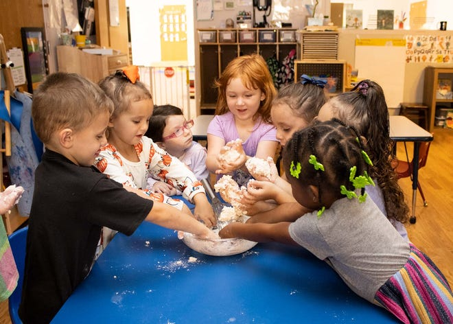 Students making homemade playdough in one of our Stricker Center classrooms.