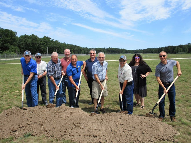 Wielding shovels at the ceremonial groundbreaking for a hangar at Oconto-J. Douglas Bake Municipal Airport were Kevin Noack, County Board Chair Paul Bednarik, Oconto Mayor Lloyd Heier, John Ebeling and Paul LeTourneau. Noack, Uhl, Ebeling and LeTourneau are members of the Airport Commission. Behind them are Bob Bake, County Board member Gary Frank, County Administrator Kevin Hamann and then City Administrator Sara Perrizo.