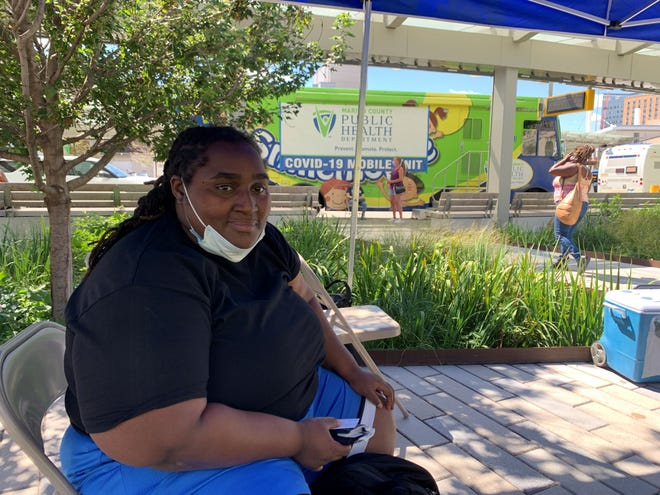 Jackie Edmonds received her first dose of the Pfizer vaccine on Wednesday, Sept. 8, 2021 at the Julia M. Carson Transit Center. The Marion County Public Health Department is hosting a weekly vaccination site through the month of September.